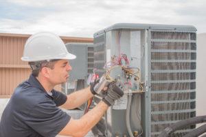 Repair specialist working on HVAC system.